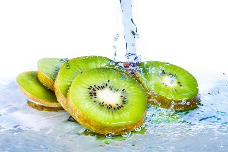 Water splash on kiwi fruit isolated on white background photo