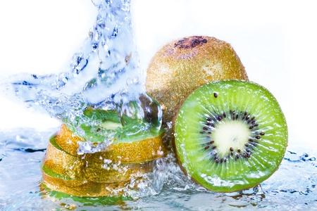 Water splash on kiwi fruit isolated on white background Stock Photo