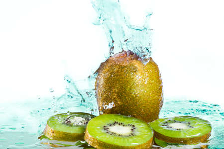 Water splash on kiwi fruit isolated on white background photo