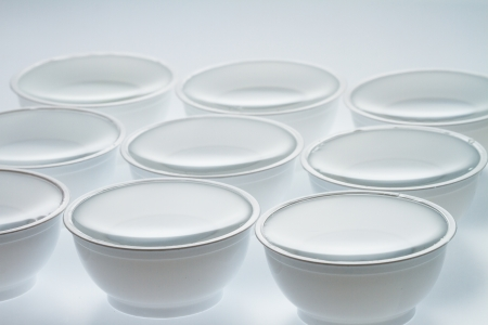 throwaway: Group of cups and water on white background