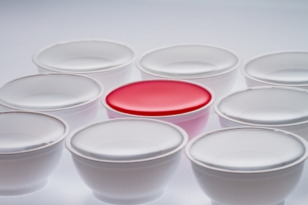throwaway: Plastic cups with red color isolated on a white background Stock Photo