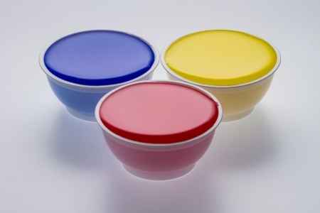 throwaway: Plastic cups with yellow, blue and red color isolated on a white background Stock Photo
