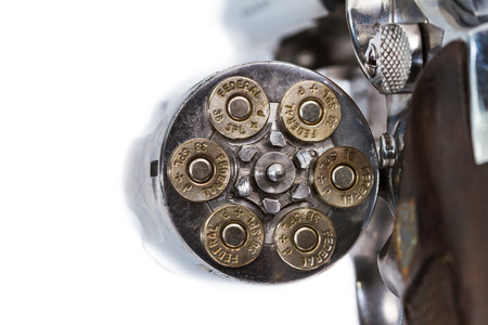 Bullets in handgun revolver Stock Photo