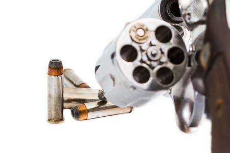 handgun revolver with bullets photo