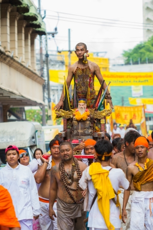 palanquin: PHUKET - OCT 10: Devotees of a Chinese Taoist shrine carry a palanquin housing a Chinese God idol in a street procession to mark the Phuket Vegetarian Festival on Oct 10, 2013 in Phuket, Thailand.
