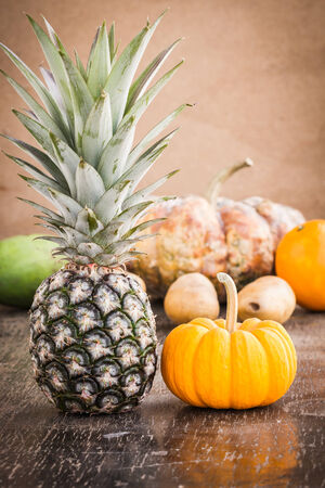 Pineapple fruits on wooden table photo