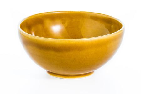 Empty brown ceramic bowl on white background Stock Photo