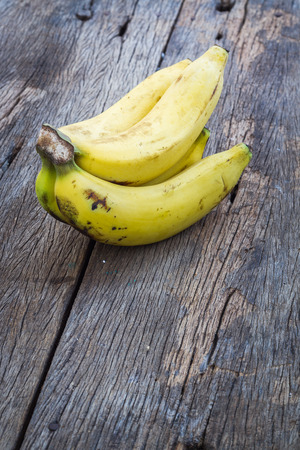 Bananas on wooden plank background
