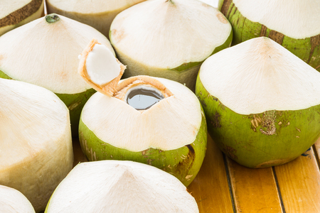Fresh coconut water drink on table