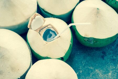Fresh coconut water drink on floor