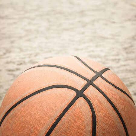 college basketball: Old basketball on street background