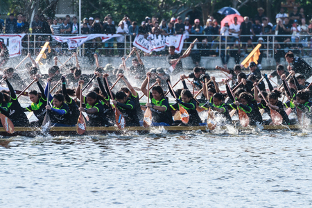boat crew: HUAHIN, THAILAND - NOV 13 : Unidentified crew in traditional Thai long boats during event boat race in honor of Majesty King Bhumibol Adulyadej on November 13, 2016 in Huahin, Prachuapkhirikhan Editorial