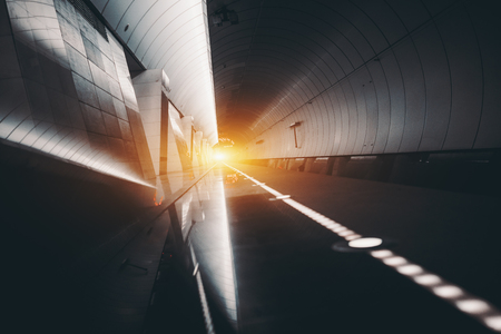 restricting: Futuristic view of subway hall with railway track, illuminated restricting line, vanishing point with flare, multiple reflections; abstract contemporary long hall of marble, metal, lights and mirrors