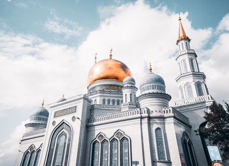 marmorate: Wide angle view from bottom of The Grand Cathedral Mosque made of white stone, with quotations from Quran on the golden dome, sunny autumn day, Moscow, Russia
