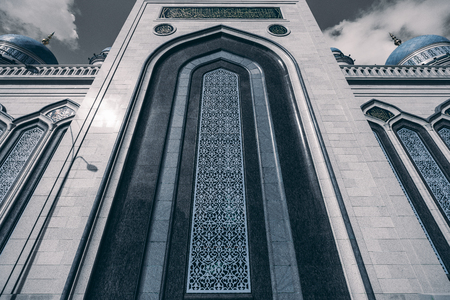 marmorate: View from bottom of The Grand Cathedral Mosque beautiful ornamental facade made of stone; caption with quotation from Quran on the top, Moscow, Russia