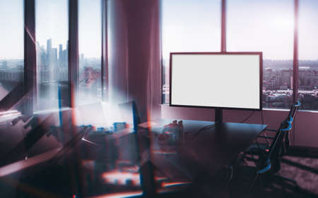 True tilt-shift shooting of abstract modern office meeting room with white blank mock-up of screen for presentations