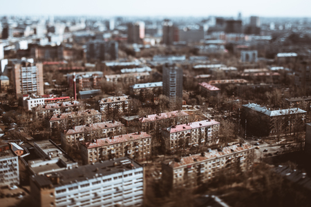 True tilt-shift view from hight point of residential district of consisted of modular prefabricated buildings, five-story block of flats houses of the Khrushchev era in Moscow, Russia; sunny spring Banco de Imagens