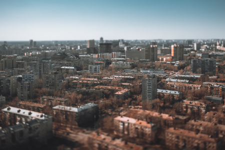 True tilt-shift shooting from high above of residential district of a five-story blocks of flats houses, modular prefabricated buildings of the Khrushchev era in Moscow, Russia; bright autumn day