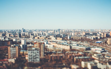 True tilt-shift view form hight point of the urban cityscape: a residential district with many houses of different size and color Banque d'images