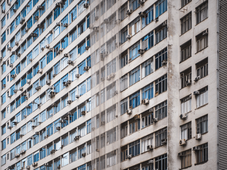 Side view of a regular beige high-rise apartment building in Rio de Janeiro, Brazil without balconies,