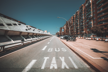 A wide-angle view of the road in a European city with inscriptions