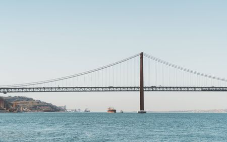A view from the water of a huge suspension bridge