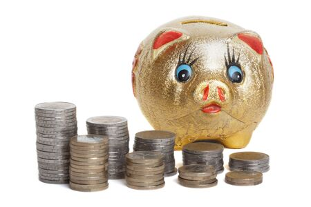 coining: Golden piggy bank with stacked coin