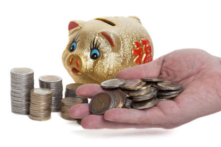 coining: Golden piggy bank with a handful coin