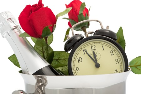 Sparkling wine pail with roses and alarm clock