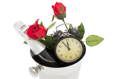 prosit: Sparkling wine pail with roses and alarm clock