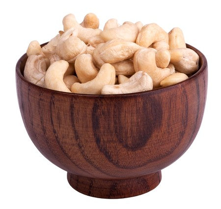 Cashew nuts in a wood bowl Stock Photo