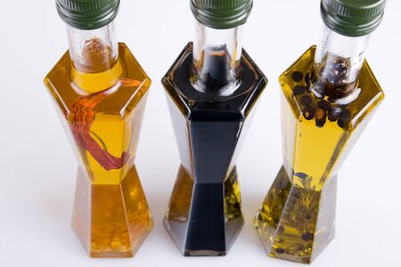 Different edible oils into bottles filled