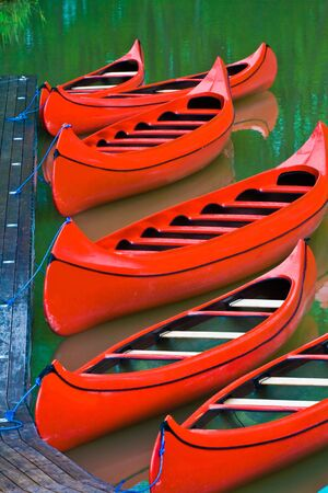 landing stage: Red canoes at the landing stage
