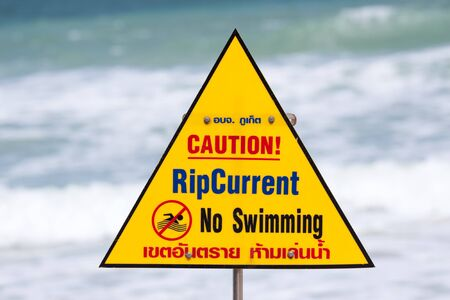 commanded: Warning sign with note on the beach