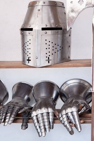 medieval weapons: Protective medieval weapons, helmet and gloves Stock Photo
