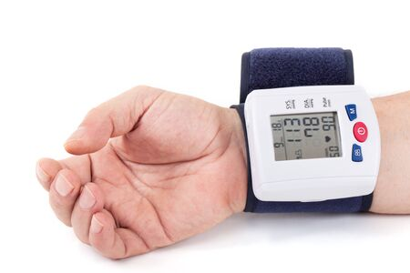 checking: Checking blood pressure at the wrist