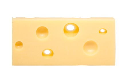 Swiss cheese with holes in front of white background photo