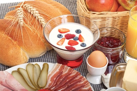 Continental breakfast with fruit, egg, sausage and bread photo