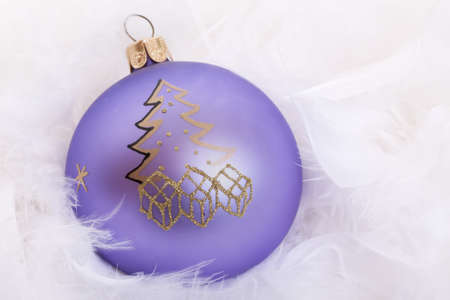 Purple Christmas tree ball with fluffy feathers photo