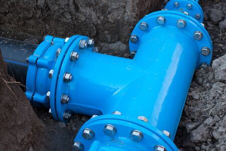 waterworks: New flange installed under the earth Stock Photo