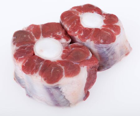 Pieces of meat from cattle in front of white background