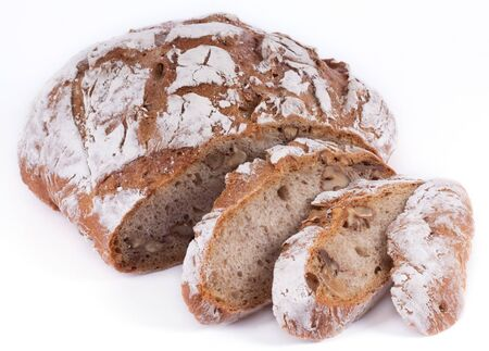 Homemade nut bread in front of white background