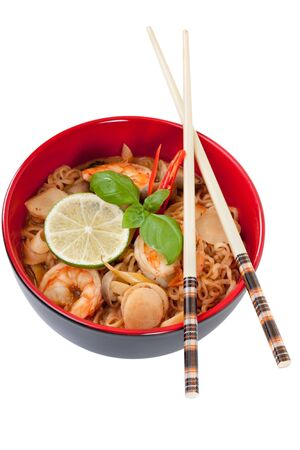 chinese bowl: Asian noodle soup in front of white background