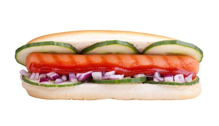 Hot dog with onions, cucumber and ketchup in front of white background  photo