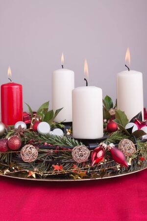 Advent wreath decorated for Christmas with lighted candles photo