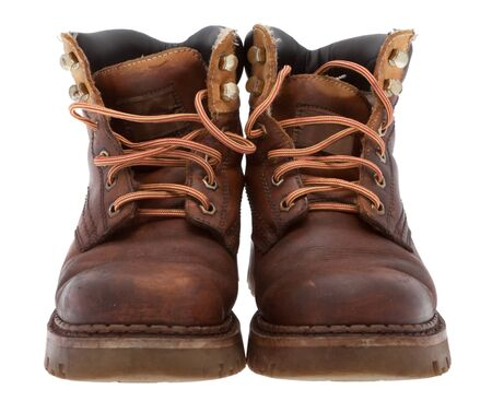 Old work boots in front of white background Stock Photo - 8548659