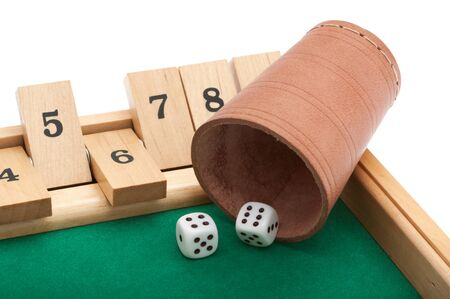 Gambling with dice in front of white background and clipping Path Stock Photo