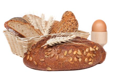 Bread and pastries in a basket in front of white background photo