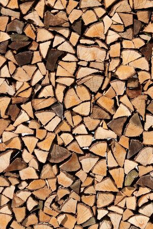 Firewood stacked for a background Stock Photo