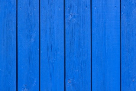 knothole: Blue wooden boards with nails for background